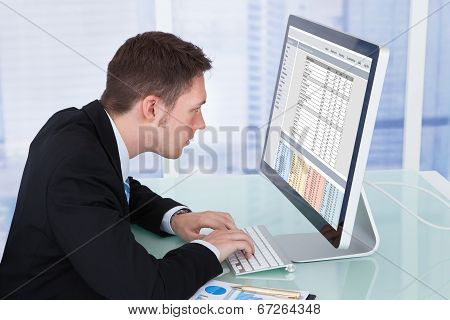 Concentrated Businessman Working On Computer In Office