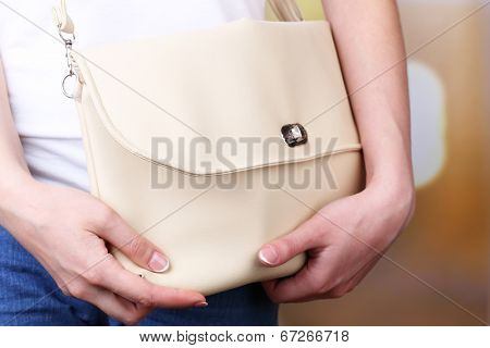 Girl with bag over his shoulder