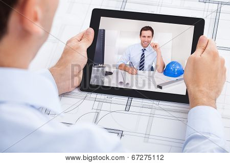 Architect Video Conferencing With Colleague