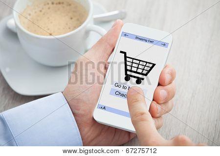 Businessman's Hands Shopping Online Through Smartphone