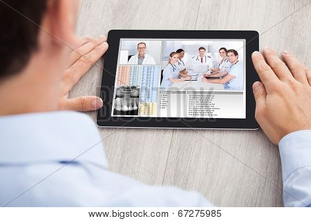 Businessman Video Conferencing With Medical Team
