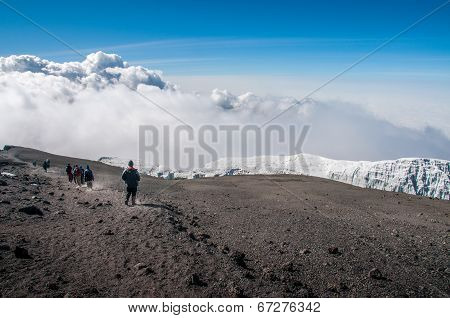 Group Descending From Summit Of Kilimanjaro