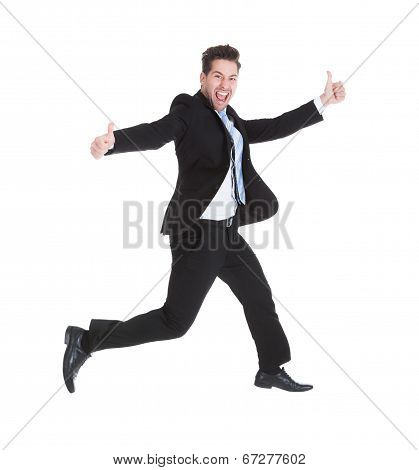 Businessman Running While Gesturing Thumbs Up