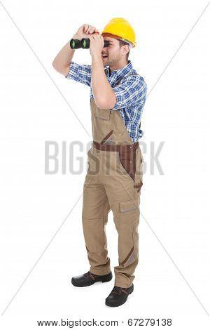 Male Repairman Looking Through Binoculars