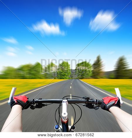 Rider driving bicycle. Motion blurred background