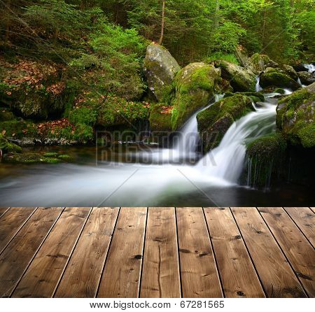 Mountain creek with wooden planks