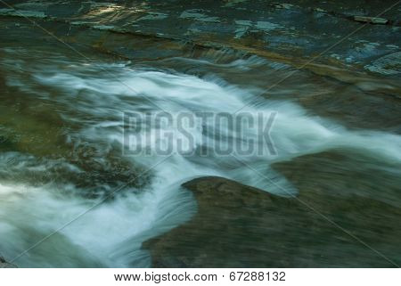 Jagged waterfalls with frosty water