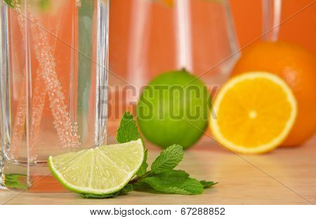 Glass with drink, citrus and spearmint leaf