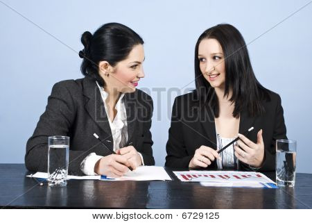 Business Women Conversation At Meeting