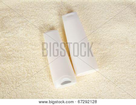Shampoo and balm on a terry cloth