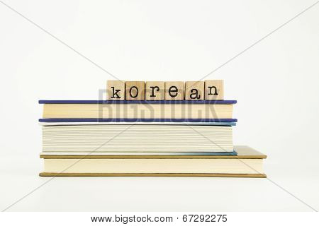 Korean Language Word On Wood Stamps And Books