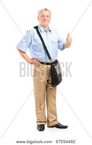 Full length portrait of a mature mailman giving a thumb up isolated on white background
