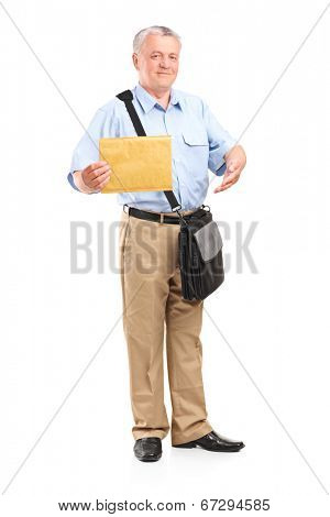 Full length portrait of a mature mailman holding an envelope isolated on white background