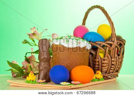 Eggs, an Easter cake, rabbit and alstromeria
