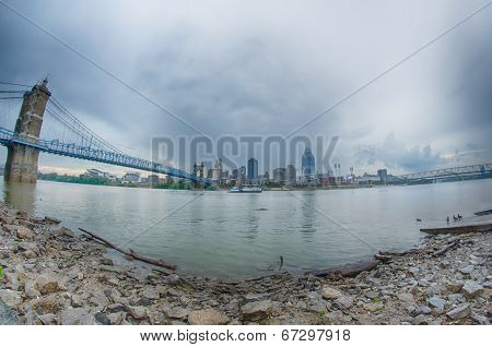 Cincinnati Skyline. Image Of Cincinnati Skyline And Historic John A. Roebling Suspension Bridge Cros