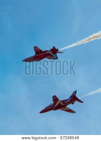 The Red Arrows jet planes British RAF aerobatic display team with teamwork and smoke
