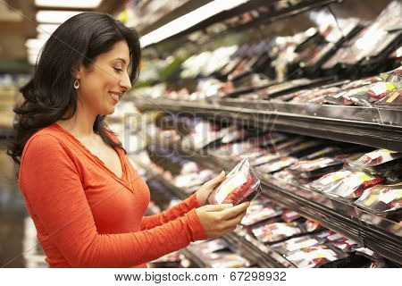 Woman shopping in supermarket