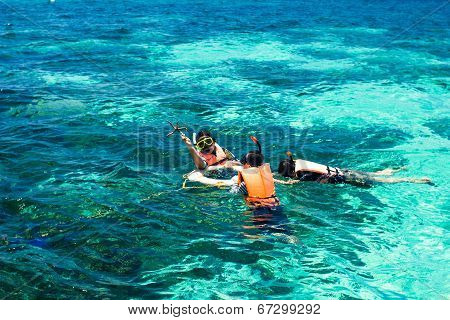 SUTUN, THAILAND MARCH 15, 2014: Tourist snorkel diving at Koh Lipe Of Andaman sea