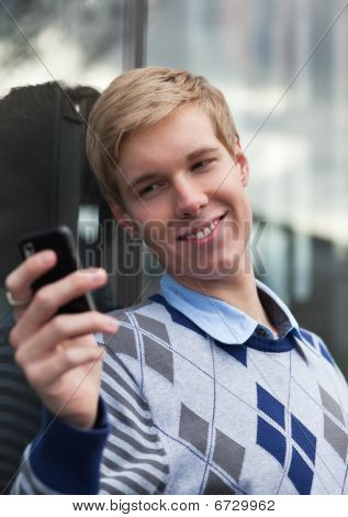 Young Man With Cameraphone