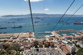 pic of gibraltar  - A view to Spain over the main port on Gibraltar from the cable car that ascends the rock.