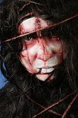 stock photo of lunate  - Scary girl from a horror movie - JPG