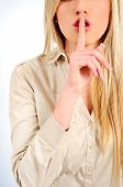 picture of shhh  - Young woman with blonde hair on gray background - JPG