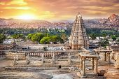 stock photo of karnataka  - Virupaksha temple view from Hemakuta hill at sunset in Hampi Karnataka India - JPG