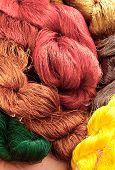 image of silk worm  - Colorful of raw silk threads stack on the floor - JPG