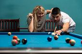 picture of pool ball  - Young Caucasian Man Receiving Advice On Shooting Pool Ball While Playing Billiards - JPG
