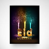 stock photo of eid mubarak  - Colourful fireworks with golden text Eid Mubarak - JPG