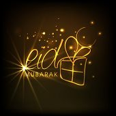 picture of eid mubarak  - Stylish golden text Eid Mubarak with gift box on shiny brown background for Muslim community festival Eid Mubarak celebrations - JPG