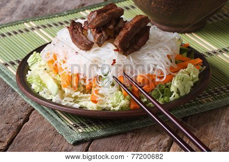Rice Noodles With Meat And Vegetables Close-up On The Table
