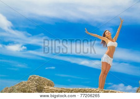 young happy beautiful woman outdoor portrait, beach and sky background