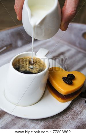 Someone Adds Milk To Black Coffee