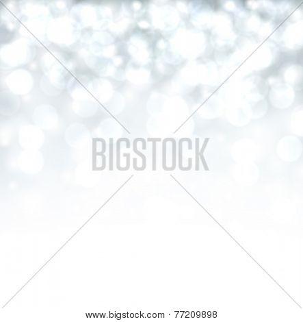 Silver defocused christmas background. Bright bokeh. Vector illustration.
