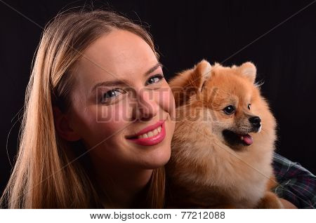 Beautiful Girl And Pomeranian Dog