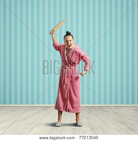 screaming housewife with rolling pin in the room