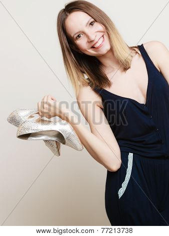 Stylish Woman Fashion Girl Holds High-heeled Shoes