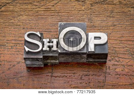 shop word in mixed vintage metal type printing blocks over grunge wood