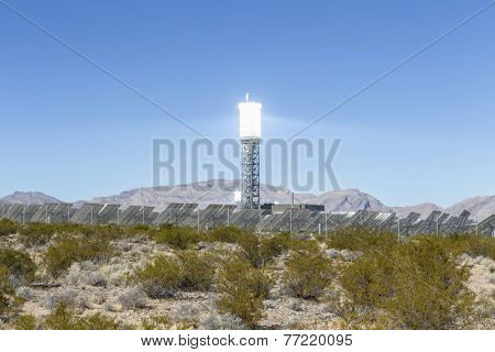 IVANPAH, CALIFORNIA - November 26, 2014:  White hot solar reflective power tower at the massive Ivanpah solar power station in the Mojave desert.