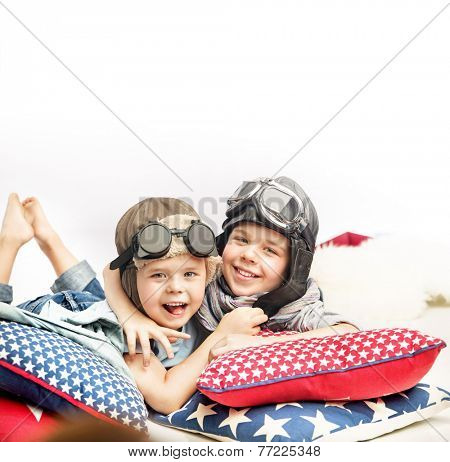 Two boys in a pilot hats