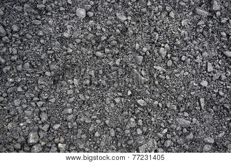 The texture of fresh asphalt lined close up. Pavement background
