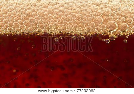 Macro shot of bubbles in a glass of soda
