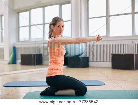 Young Fitness Woman Working Out At Gym