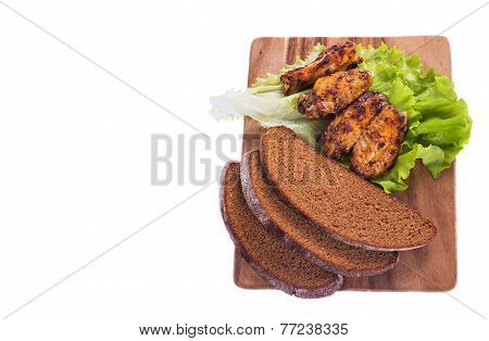 Grilled Meat And Black Bread On The Kitchen Blackboard