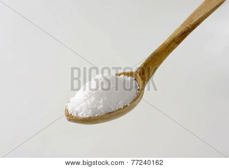 heaping wooden spoon of sea salt