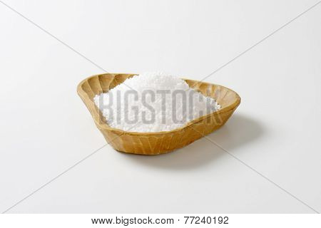 portion of sea salt in the handmade wooden bowl