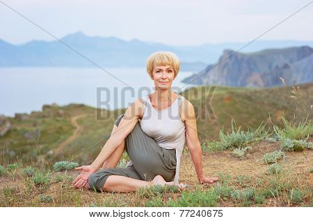 Senior woman doing yoga exercises