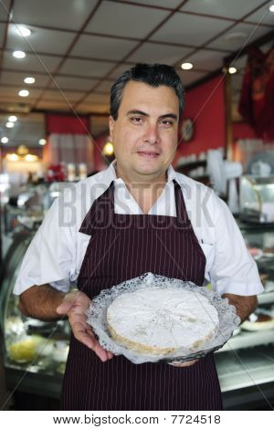 Small Business: Waiter Showing A Tasty Cake