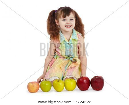 Happy Child With Apples Of Different Color And Size